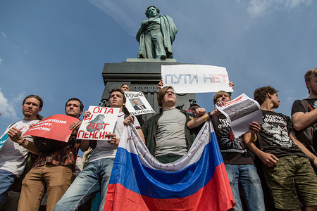 People seen holding posters, banners and flags during the protest against the planned increase in pension age nationwide in Moscow.