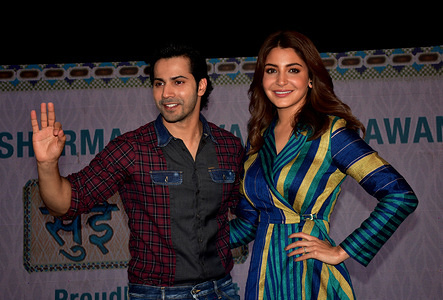 Indian film actress Anushka Sharma and  actor Varun Dhawan seen posing for photos during a promotional event at YRF Studio in Mumbai for the upcoming film, Sui Dhaaga.