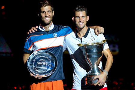 Martin Klizan of Slovakia (L) and first place Dominic Thiem of Austria seen possing with their trophies after the final match  of the St. Petersburg Open ATP tennis tournament in St.Petersburg, Russia